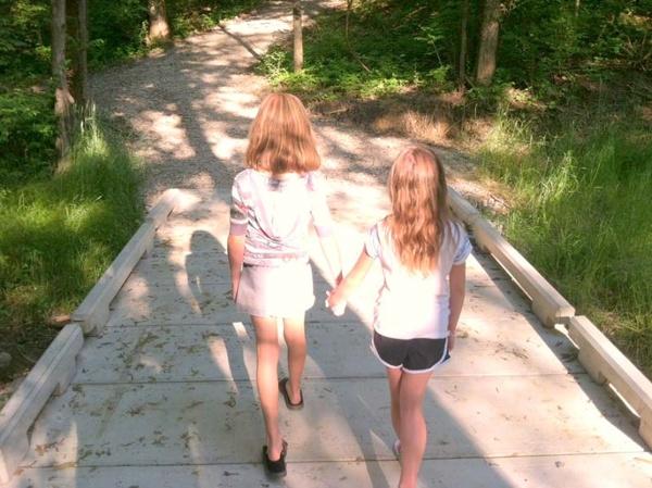 Girls Walking On Riverside Drive Boardwalk