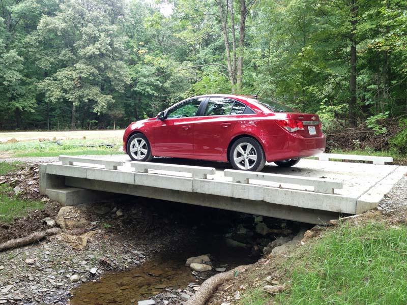 Car on Concrete Stream Crossing
