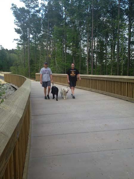 Walking Dogs on White Oak Greenway PermaTrak Boardwalk