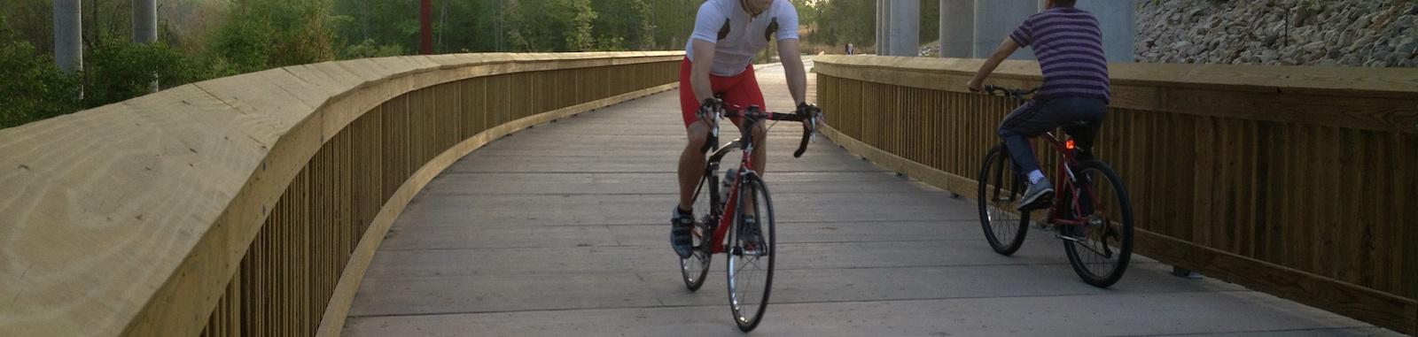 cyclists_on_boardwalk_top_image.jpg