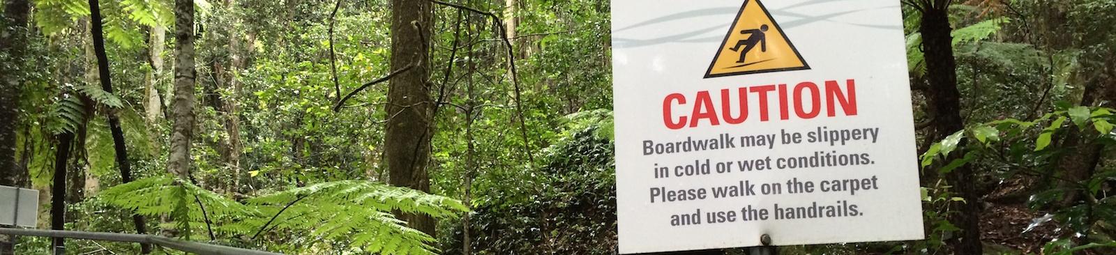 slippery_boardwalk_warning_sign_background.jpg
